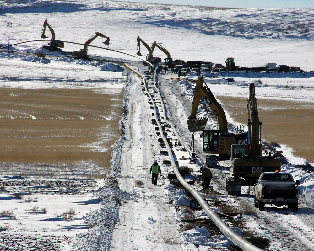 Pipelines carry some of the oil and natural gas liquids (NGL). This picture shows construction of the BakkenLink Pipeline. BakkenLink will carry crude oil about 130 miles through Billings, McKenzie, Stark and Williams Counties.