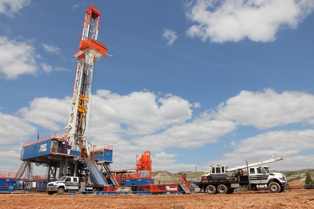 Trucks bringing equipment to a drilling site
