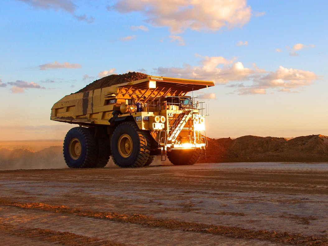 Large trucks are used at a coal mine to help move materials.