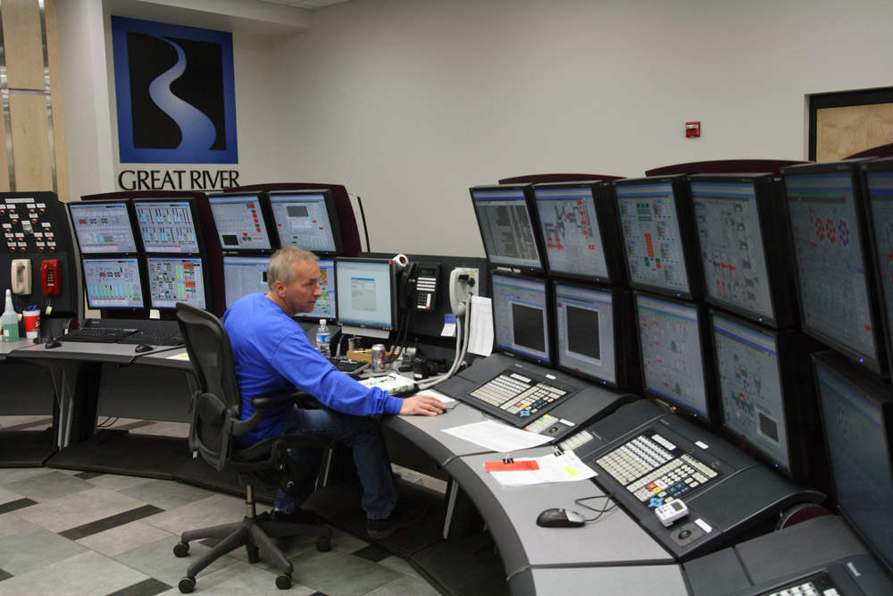A power plant operator monitors equipment.