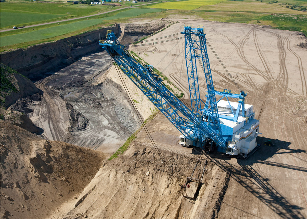 A dragline at the Freedom Mine near Beulah digs into the earth.