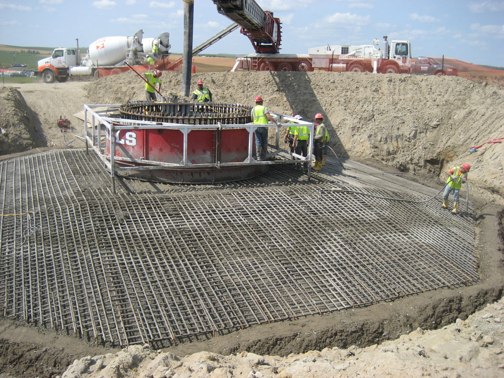 A grid of steel is arranged to prepare the foundation of the wind tower.