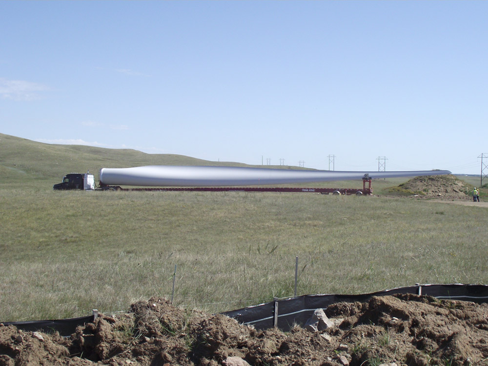 A blade is delivered to the construction site for the Bison Wind Energy Center.