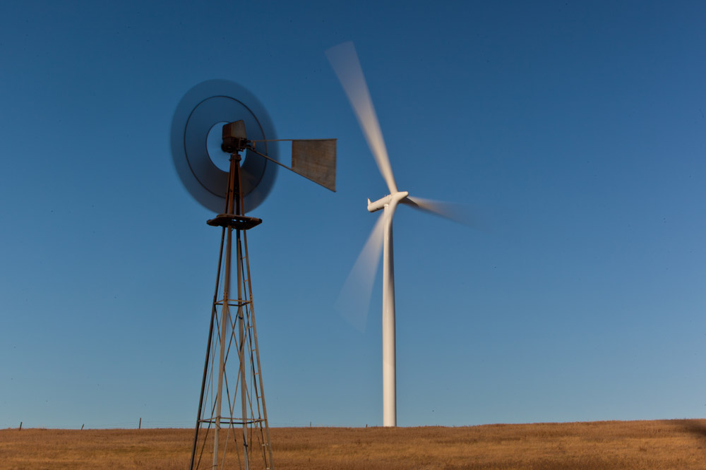 Image 2: An old windmill stands next to the modern version. Early versions of windmills pumped water for <u>household use</u> and to fill water tanks for <u>livestock</u>. Modern windmills are used to generate electricity.