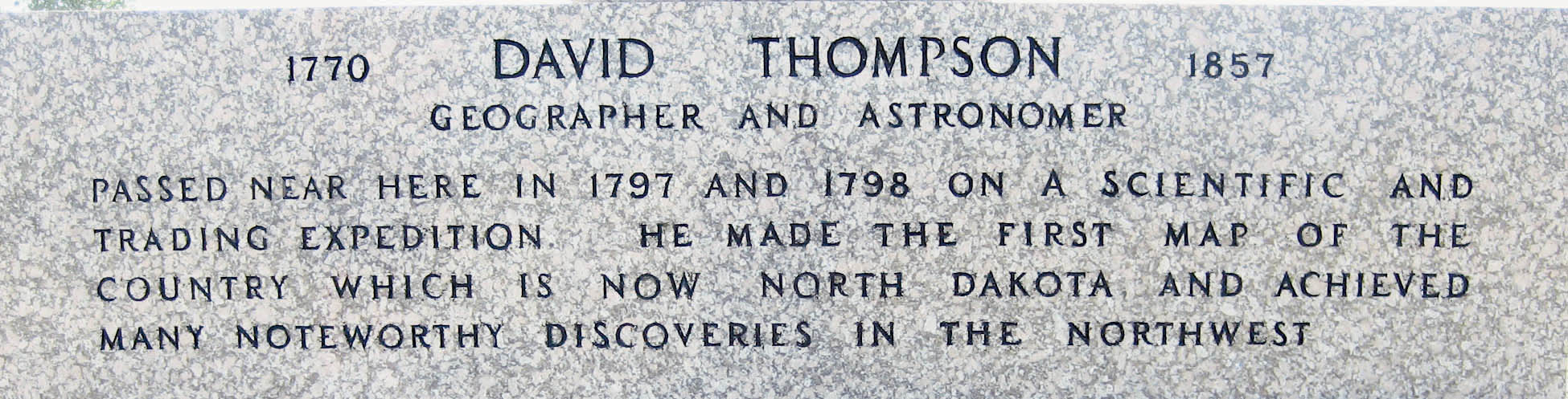 The inscription at the base of the David Thompson Memorial.