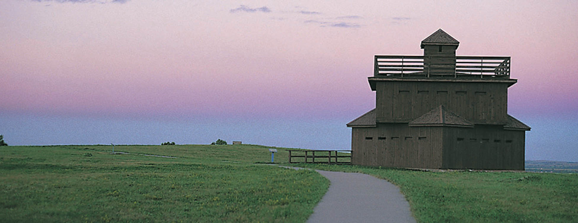 <strong>Figure 85. Reconstructed blockhouses at Fort Abraham Lincoln</strong> south of Mandan, North Dakota. <em>(ND Tourism, WE0038)</em>
