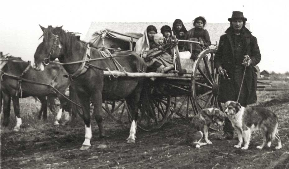 A Chippewa family shown with a Red River cart