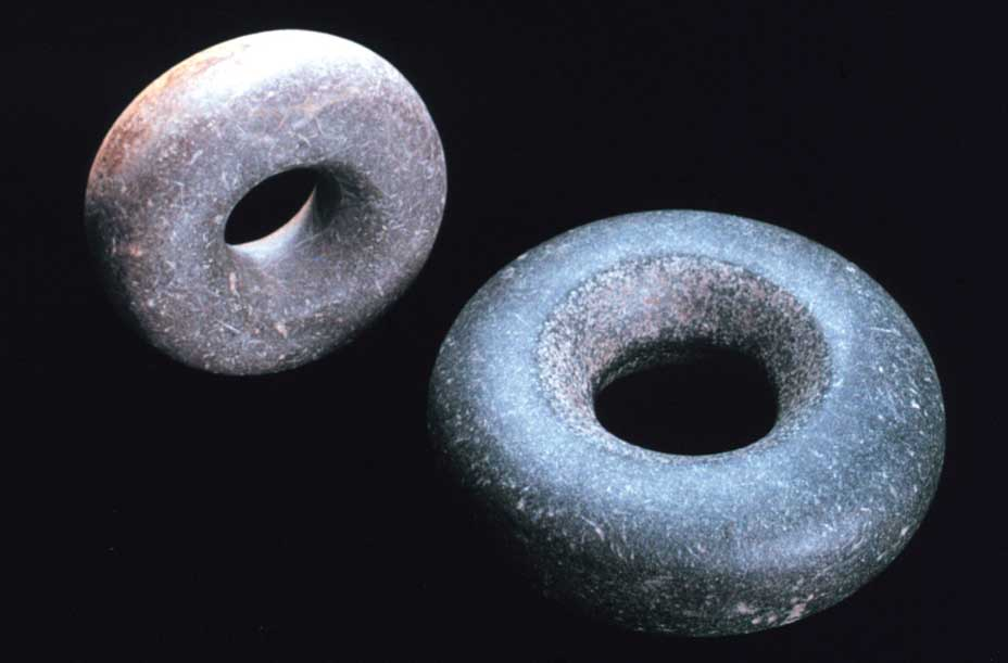 These are donut-shaped Tchung-kee game stones