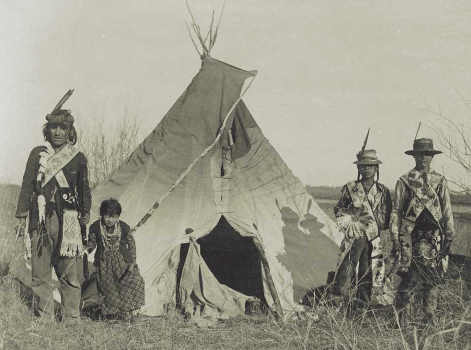 Chippewa family next to their tipi