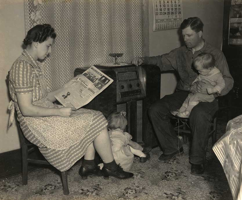 Figure 56. This farm family enjoys listening to an electric radio