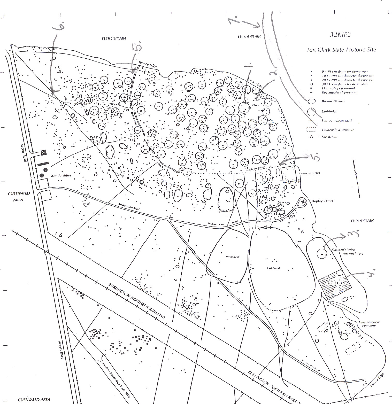 Archaeologist Raymond Wood made this drawing of the remains of Fort Clark and the nearby Mandan village.  In the lower right corner, the shaded rectangle shows the location of Fort Clark.  The small circle just above (north ) was the site of Pierre Garreau's lodge.  Garreau was the son of a French fur trader and a Mandan woman.  He lived in the Mandan style.  The circles are the sites of lodges in the village.  The village ceremonial lodge (No. 1) and the village plaza (No. 2) were located close to the river bank.  The village, called Mitu'tahakto's (meh Toot ah hang tosh), was built in 1822 with a palisade wall (No. 5) for protection.  Trails were dug into the earth by travois poles dragging behind horses.  The trails are still visible (No. 6).