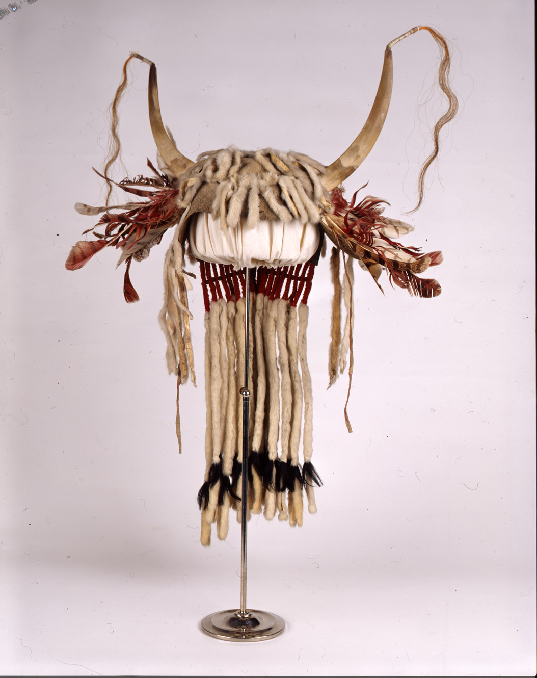 """Weasel Tail Headdress.""  This very special headdress was decorated with weasel tails.  It would have been worn for ceremonies.  This headdress was owned by Crazy Dog. SHSND Museum 00973"