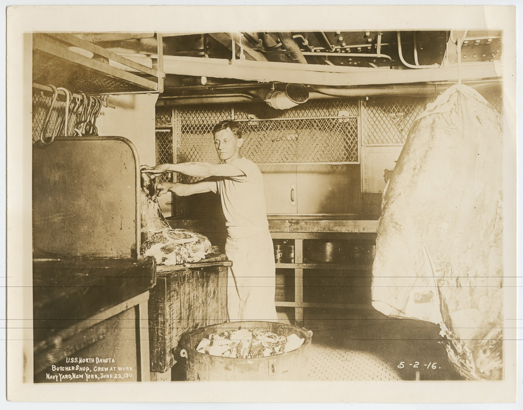 This young seaman's duty was to prepare meat for the men's meals.