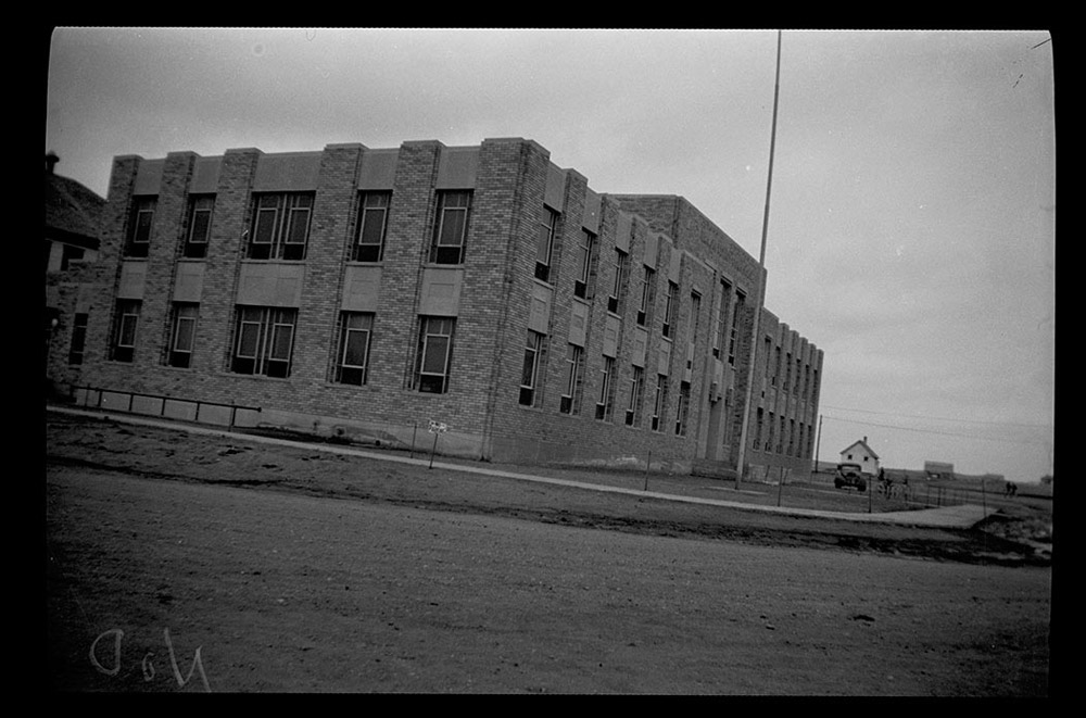 30573-0061. The WPA designed and built the Emmons County Courthouse in Linton. The building replaced a cramped and outdated building. The project provided employment for many local men. The WPA built six other county courthouses in North Dakota during the 1930s. <span class='figure-archive-id'> SHSND 30573-0061.</span>