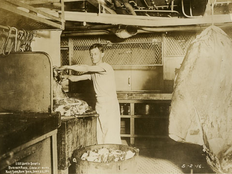 Sailor preparing meat for meals