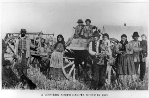 Metis Family and a Red River Ox Cart, circa 1883